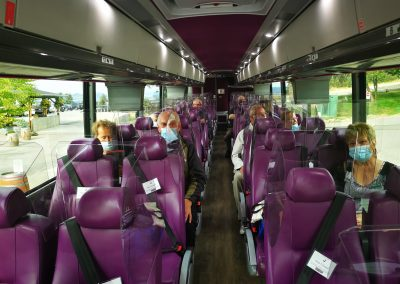 Passsengers in divided seats on coach, social distanced by space with closed rows
