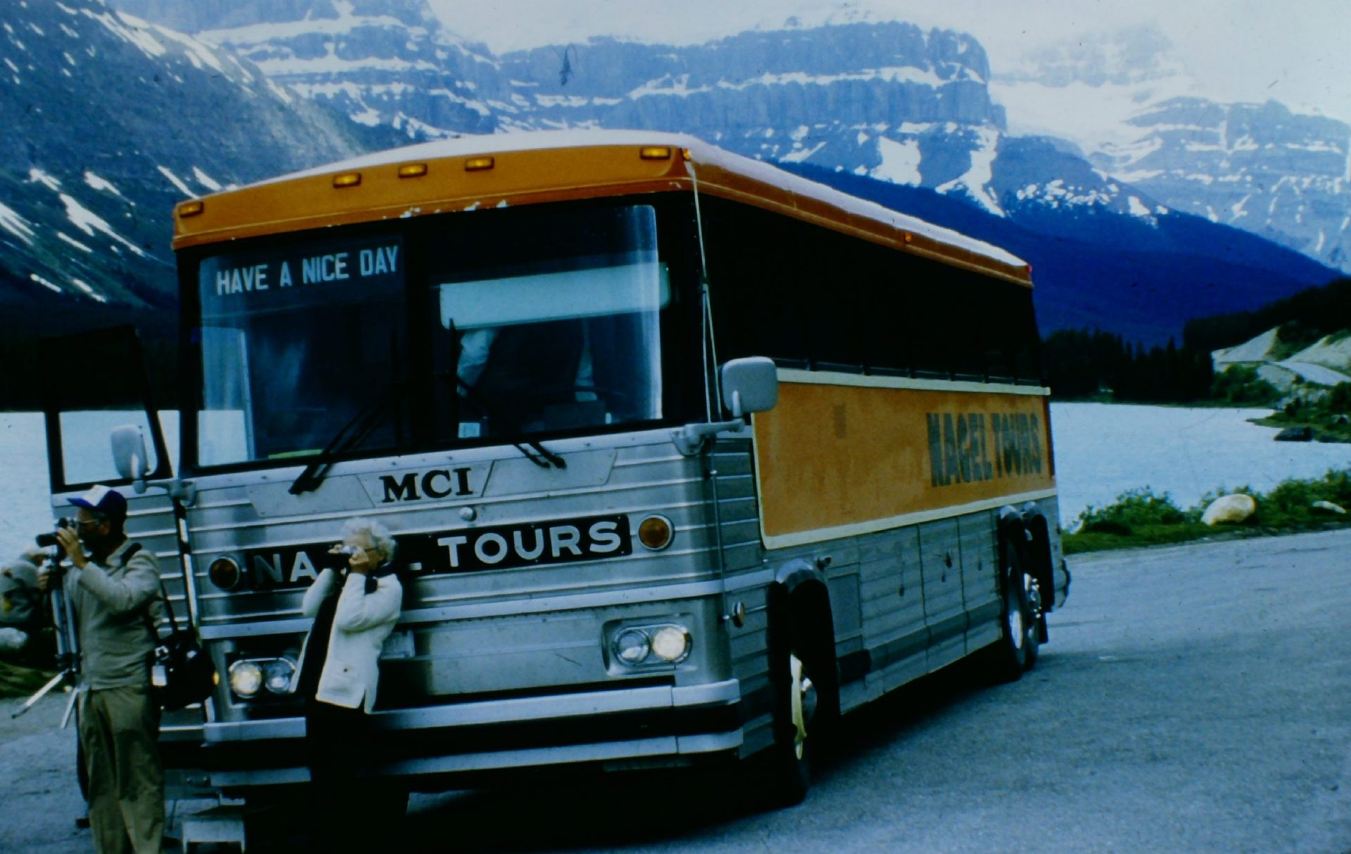Classic MCI MC-9 Nagel Coach mountains and lake